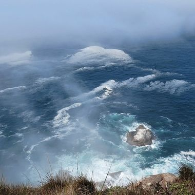 Taken in California, Point Reyes. It was pretty foggy that day, but the view from atop the cliffs was amazing.