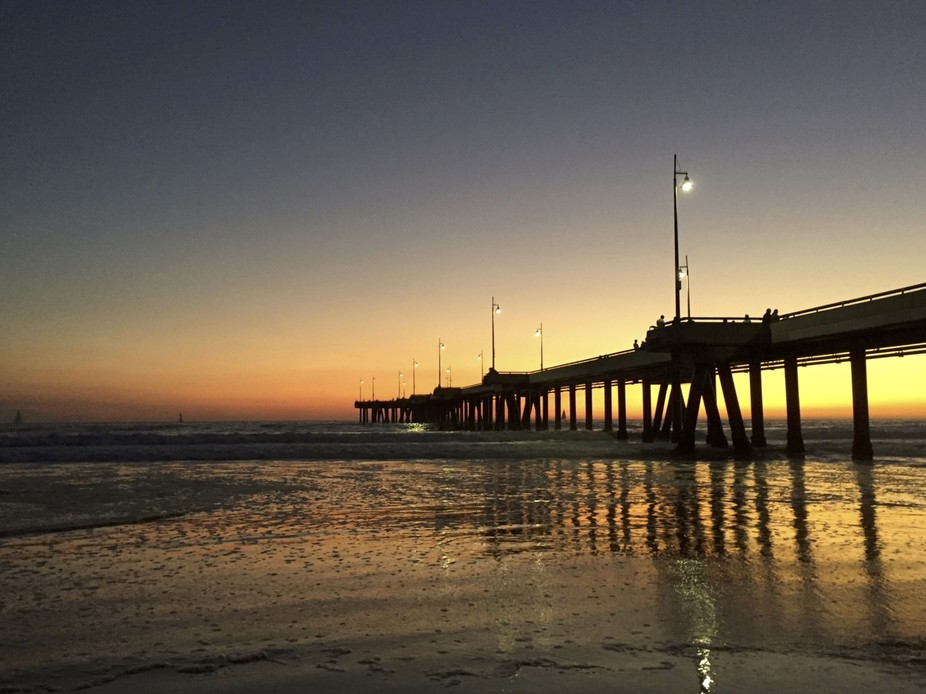 Went down to the beach at the pier without a camera. As the sun was setting, I couldn't ...