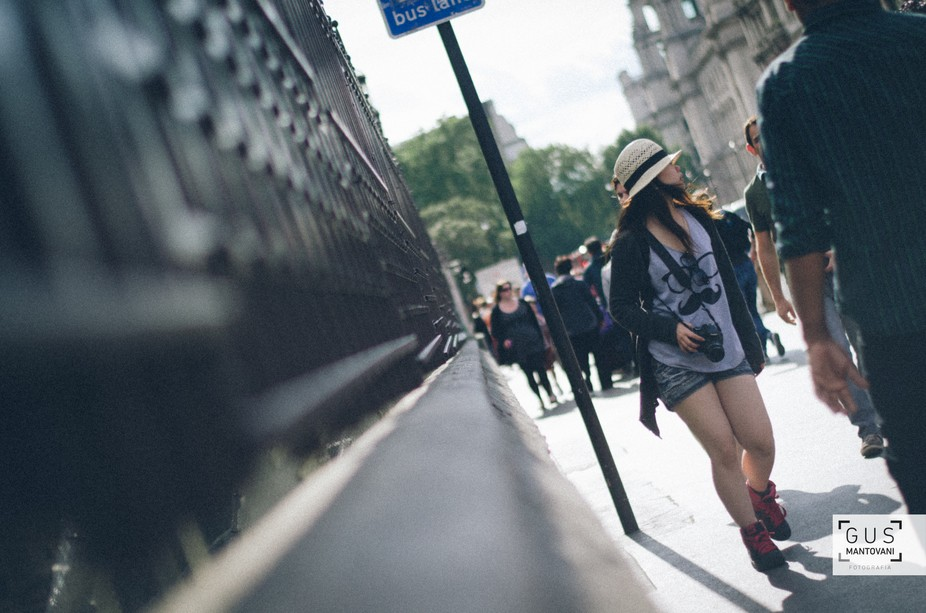 Tourist woman walking beside the Palace of Westminster in London, UK.