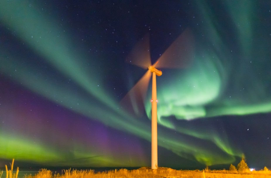 The Northern Lights and windmill in the Bothnian Bay.