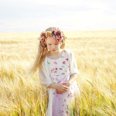Child walks in the wheat fields.