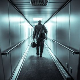 I saw this man walking in front of me while getting on a plane, and his posture really interested me. I stopped in the middle of the walk way, to...