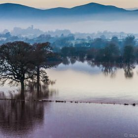 The River Severn, in the early hours, south of Worcester flooding the Powick Hams. In the background are the Malvern Hills. As featured in The Gu...