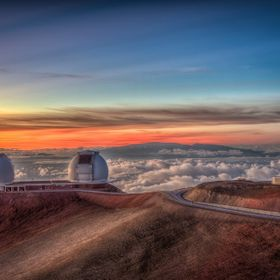 Sunset on top of Mauna Kea in Hawaii Big Island. In the background Haleakala on Maui is peeking over the clouds.