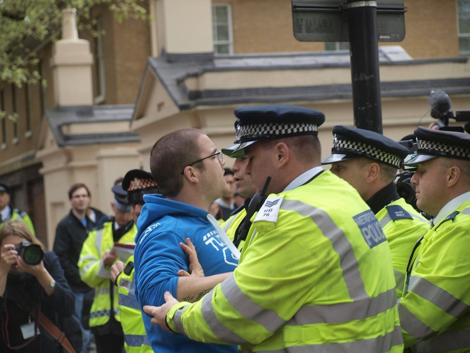 Good Friday 2014 - Regents Park Mosque, London. A counter protestor tries to break through police...