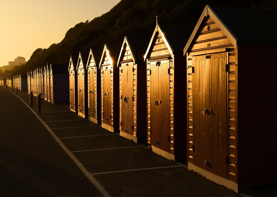 A walk along the seafront in October 2015, towards a spectacular sunset, revealed these beach hut...