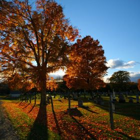 "A Fall sunset in a graveyard - double meaning for ""at the end of the day""."
