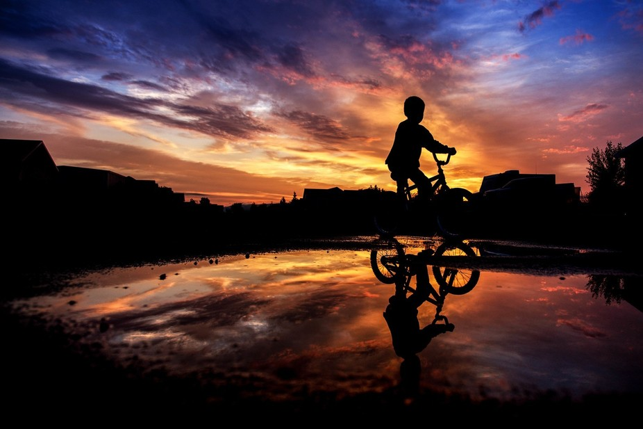 My son loves to ride his bike through puddles.  Of course, this night I was already taking pictur...