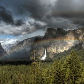 Classic view of Yosemite Valley with Bridalveil Falls in the background, enhanced by the rainbow.  If you look closely, there is a double rainbow...