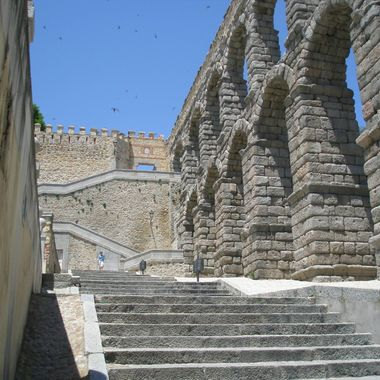 This photo was taken while we were visiting Segovia, Spain in 2010.  Specially the aqueduct captured our interest while we walking in the city.