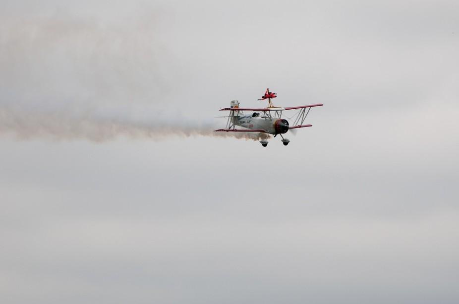 Flying girl on a smoking biplane