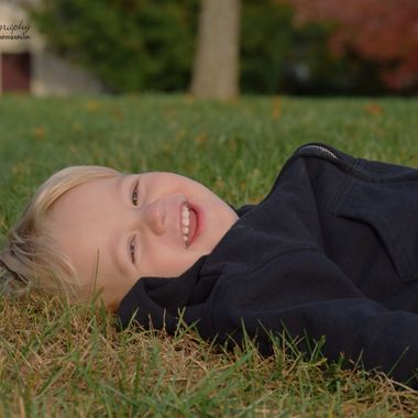 layin in the grass smiling