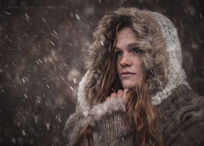 Redhead with hood in snow storm by judyhurley