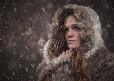Redhead with hood in snow storm