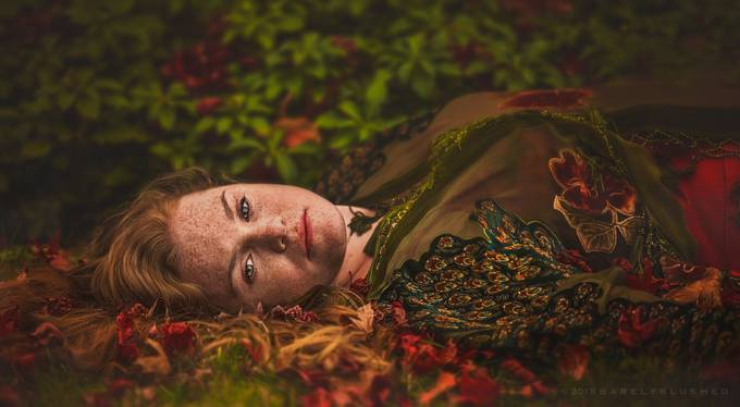 Redhead laying down in grass by judyhurley - Dramatic Portraits Photo Contest