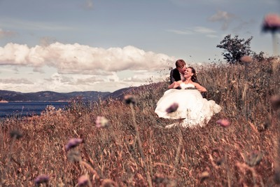 Bride & groom in a meadow, Lyngdal, Norway