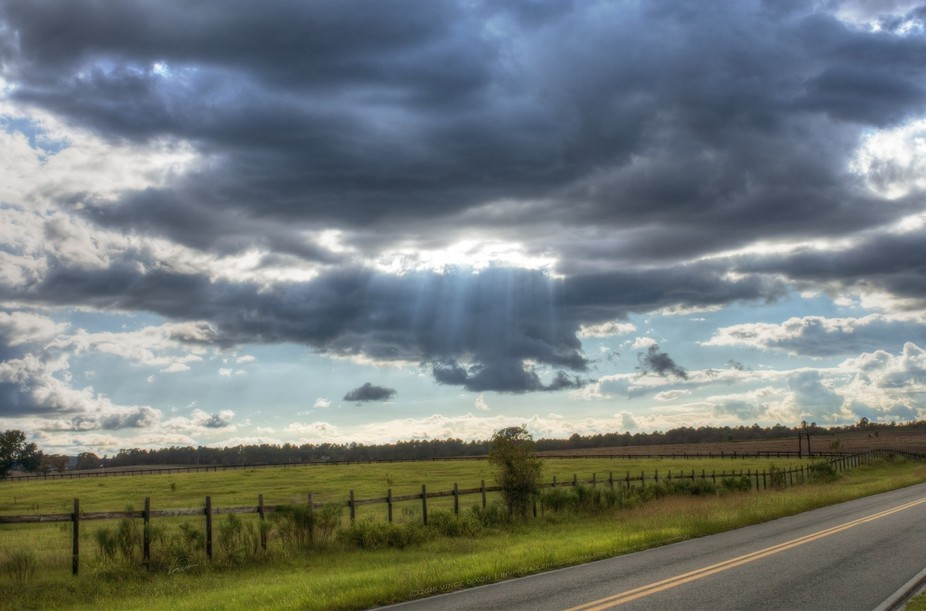 Sun rays bursting through clouds in Dunnellon, Florida USA