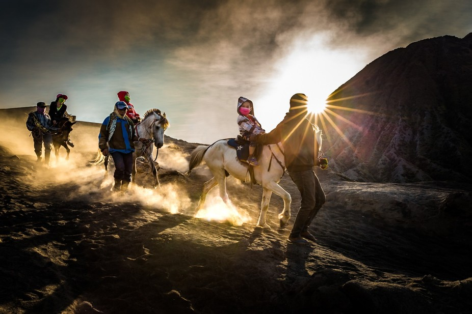Porters help tourists hike Mt Bromo and earn some easy cash in the process. Rising smoke, and the...