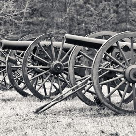 A row of cannon at a Civil War reenactment
