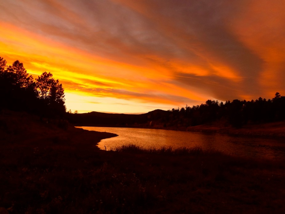 We built a cabin on a small lake in Colorado. I have taken sunrise and sunset pictures from the d...