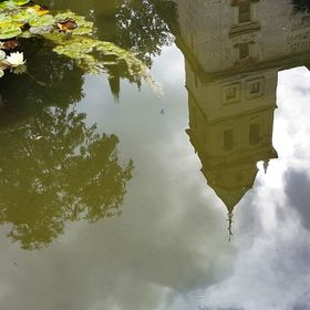 Sometimes cloudy sky and Sun peeping in & out can make a good frame. Here is a reflection shot, taken @Alhambra,Spain