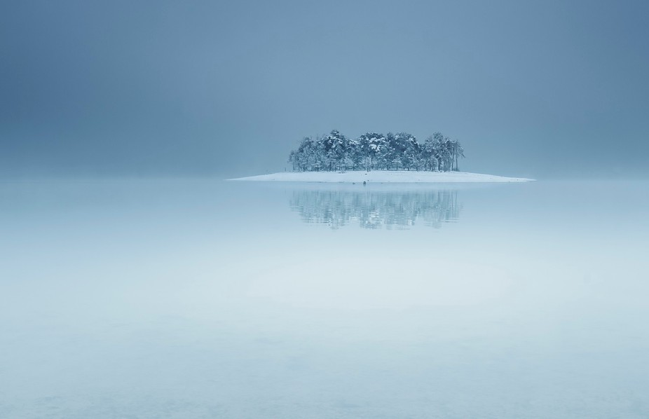 Lonely island shot during winter time at Batak dam, Bulgaria