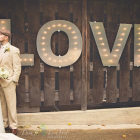 During this whole wedding we had a windstorm and rainstorm.  Branches were coming down all around us, there was no power, it was pouring.  Just b...