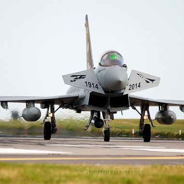 RAF Typhoon FGR4 rolls off after sortie showing special canard art work
