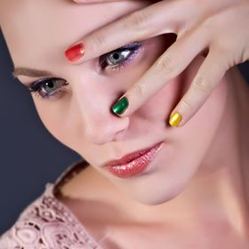 Beautiful model showing her multi colored nails