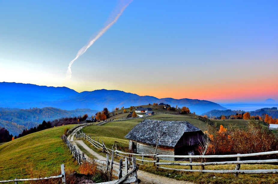 A small village in the mountain heart of Romania. As well as the day, the village is at its dusk...