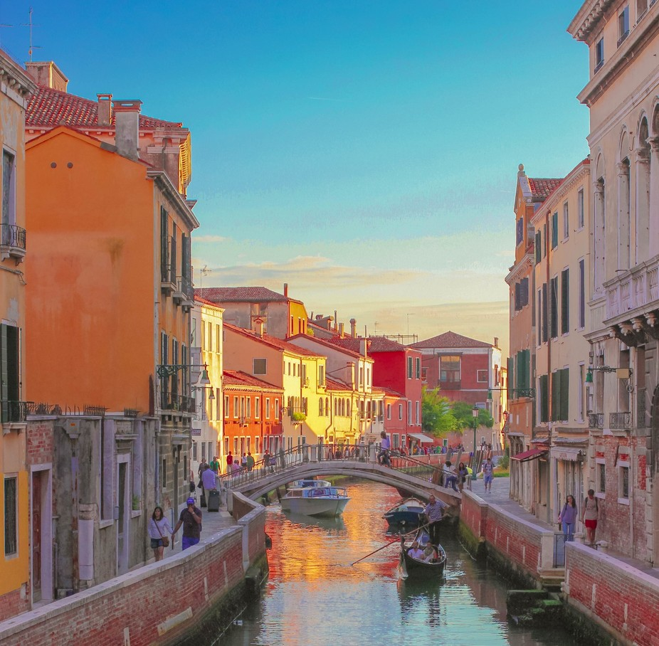 A capture of a Venetian canal and its narrow sidewalks.