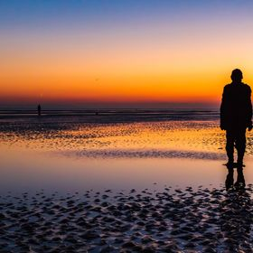 An shot of one of the Antony Gormley statues located on Crosby Beach, UK.