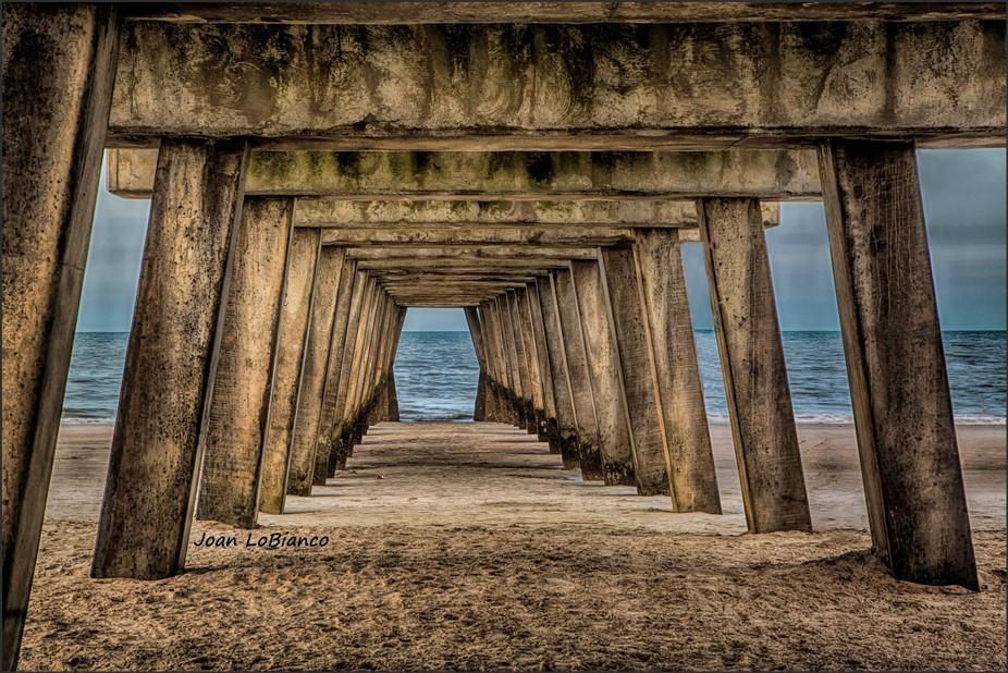 Under the pier at beach in Savanah Georgia