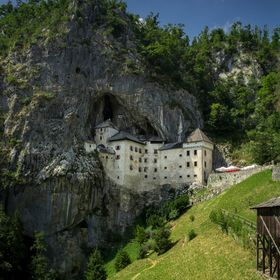 Predjama Castle in Slovenia is a unique castle in castle embedded in a mountain side dating back to the middle ages
