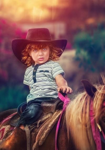 Young boy ride a horse