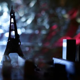 a macro shot of a computer motherboard and a hard disc needle playing Eiffel Tower :)... with an ambient back light.