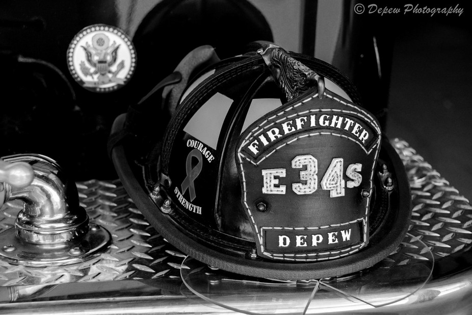 My leather firefighter helmet, supporting my son with his cancer ribbon.