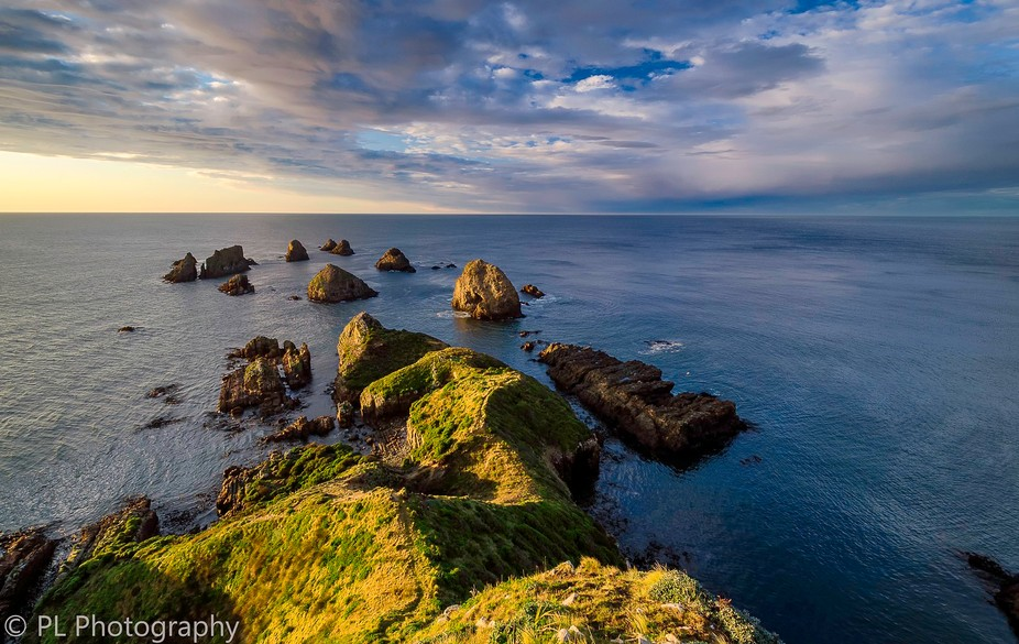 rocks formations at Nugget Point on a clear sunrise