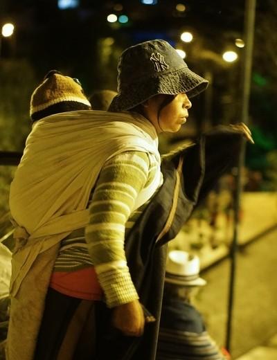 Woman Carrying Baby in Traditional Fashion, Cuenca, Ecuador