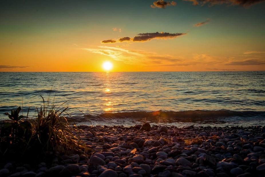 Sunset over a rocky beach on Lake Michigan in the Leelenau Peninsula of Michigan