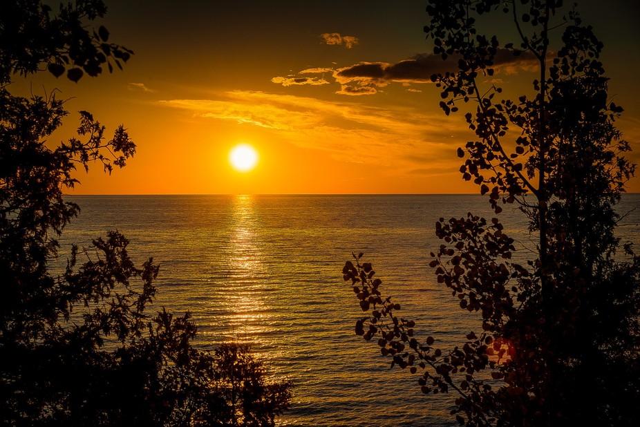 Sunset on Lake Michigan on the Leelenau Peninsula of Michigan over Peterson Park, on a warm July ...