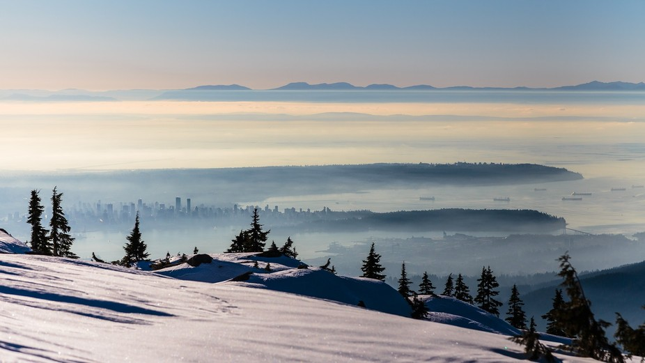 View of Vancouver Canada from above the clouds.