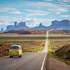 A classic Volkswagen T1 on the road in front of Monument Valley.  Sometimes you just get moment you really don`t expect.