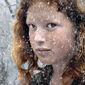 Girl with red hair in Snow.