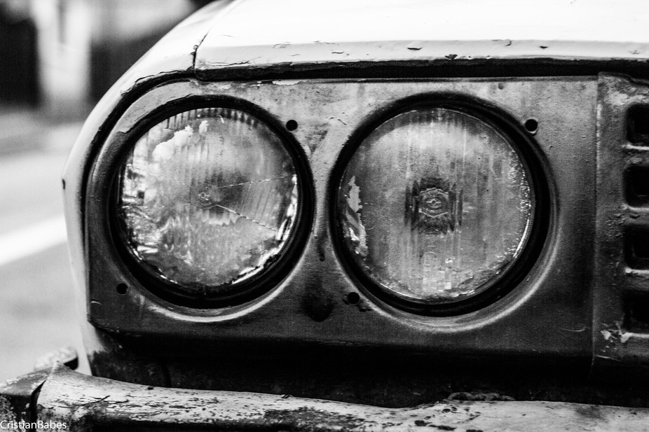 the right headlights of a Dacia 1300, one of the most common cars of the communist Romania.