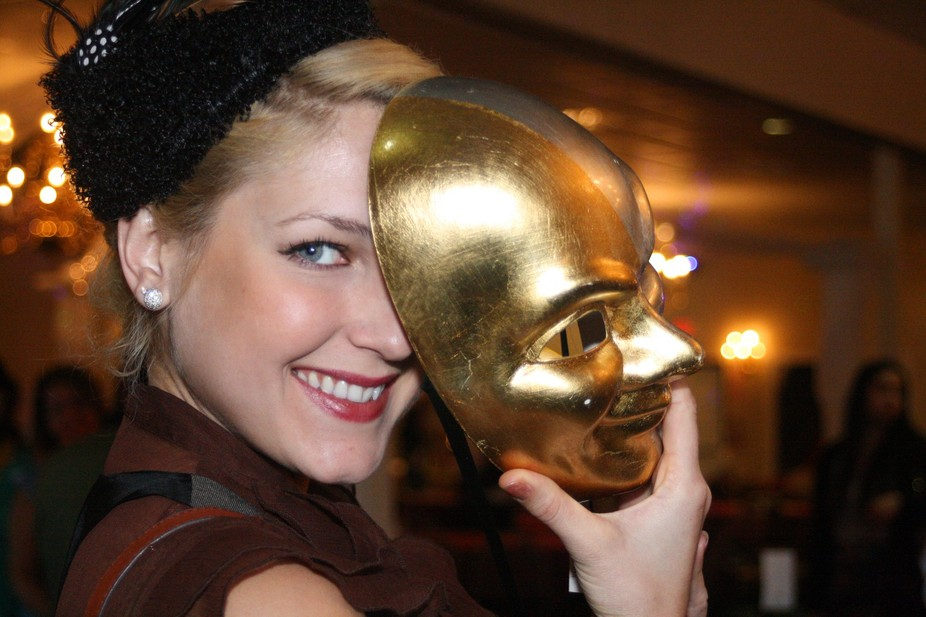 Pretty woman with gold mask.