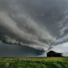 A shelf cloud overtaking an abandoned house in Saskatchewan Canada.