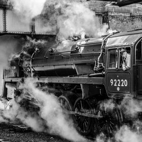 A locomotive similar to that of the British Rail standard class locomotive called 'Evening Star' which is a preserved British steam loc...