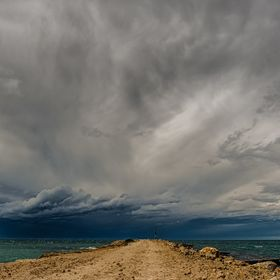 A summer storm approaches Aramoana near Dunedin, New Zealand