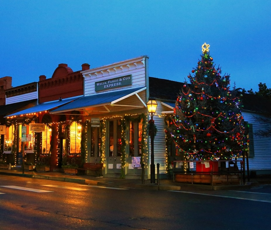 Jacksonville Oregon at Christmas Time. Historic Victorian Homes and businesses are decorated to r...